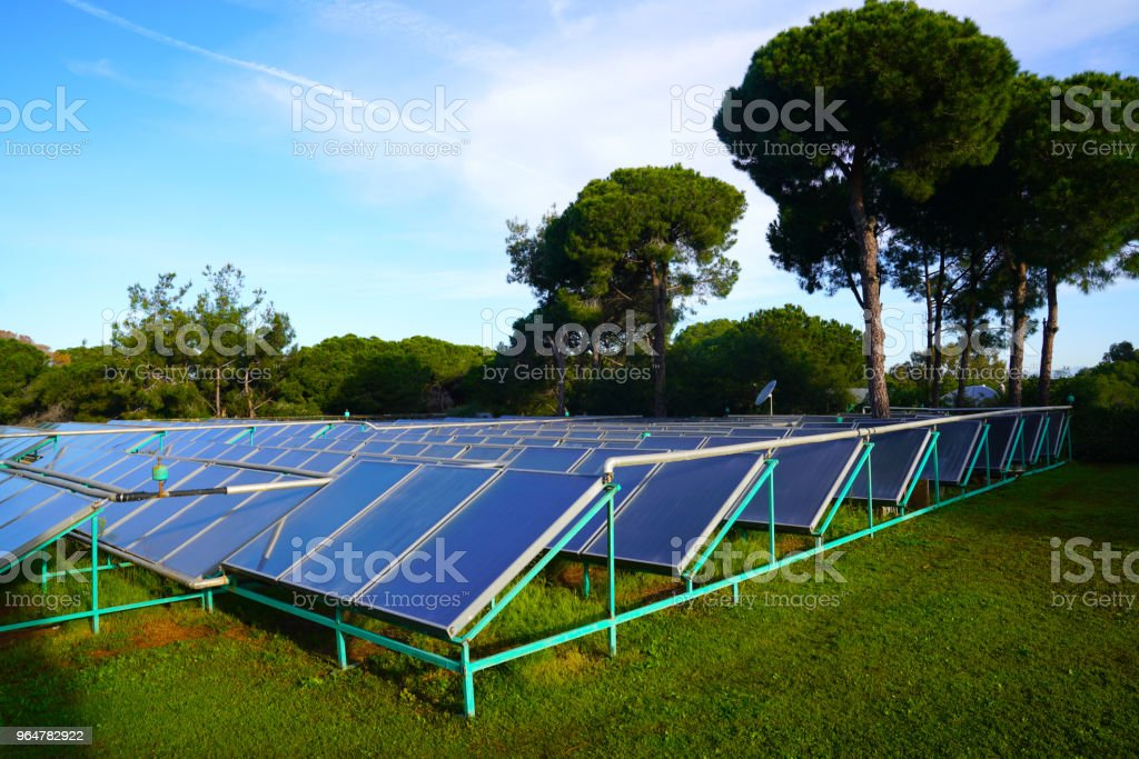 Photovoltaic power station or solar farm among trees in Antalya, Turkey royalty-free stock photo