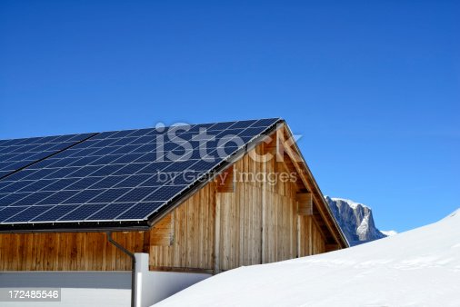 Well constructed solar roof on a wooden alpine house.