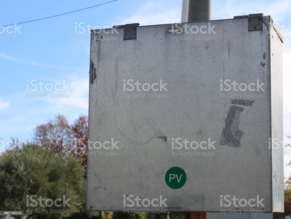 Photovoltaic (PV) safety label on residential power supply box stock photo