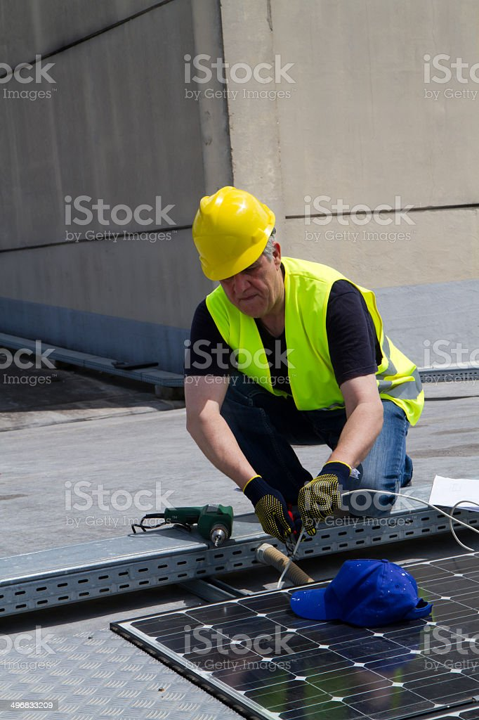 photovoltaic skilled worker royalty-free stock photo