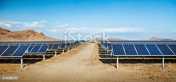 Industrial scale photovoltaic solar field installation in Rosamond, Kern County, California.