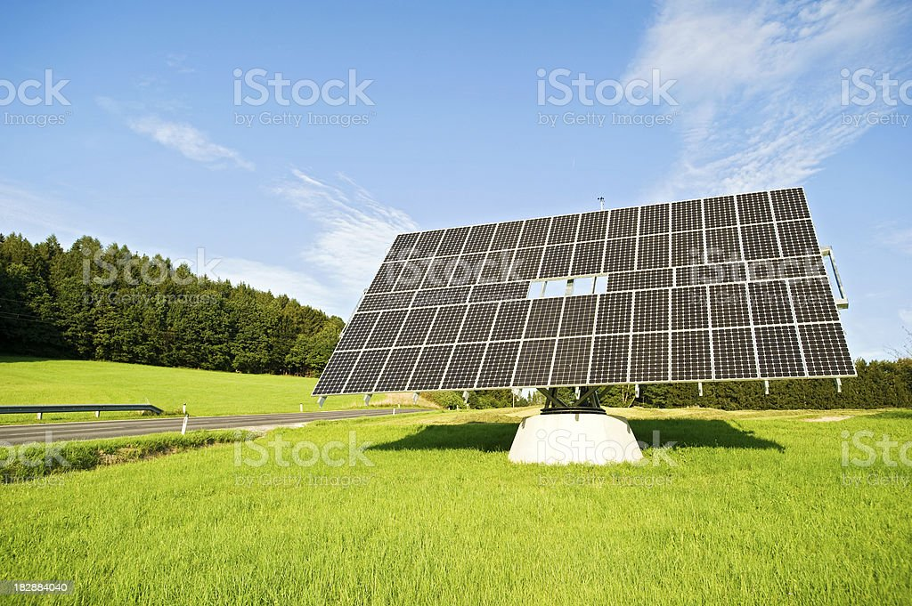 Photovoltaik -  solar panel in a green field stock photo