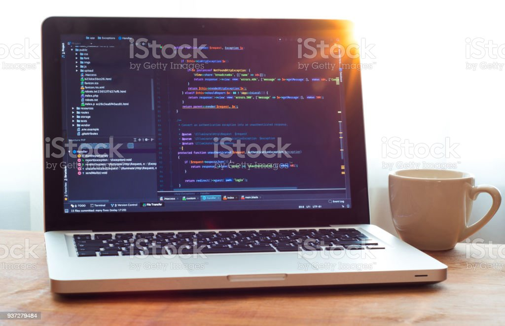 Php code on laptop (web developing) and white mug in sunlight royalty-free stock photo