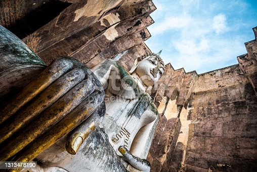 istock Phra Achana, the largest Buddha image in Sukhothai, in Wat Sri Chum Temple in Sukhothai Historical Park (Sukhothai, Thailand) 1313478190