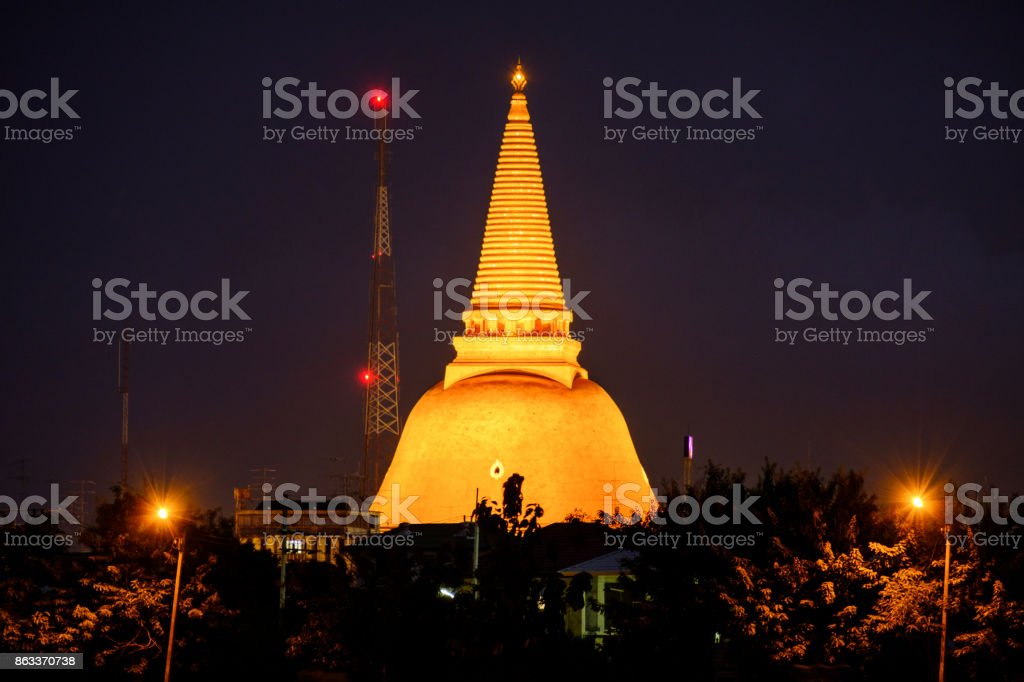 Phra Pathom Chedi Sanctuary is a vital part of Thailand. With the shadow water reflect beautiful lighting background stock photo