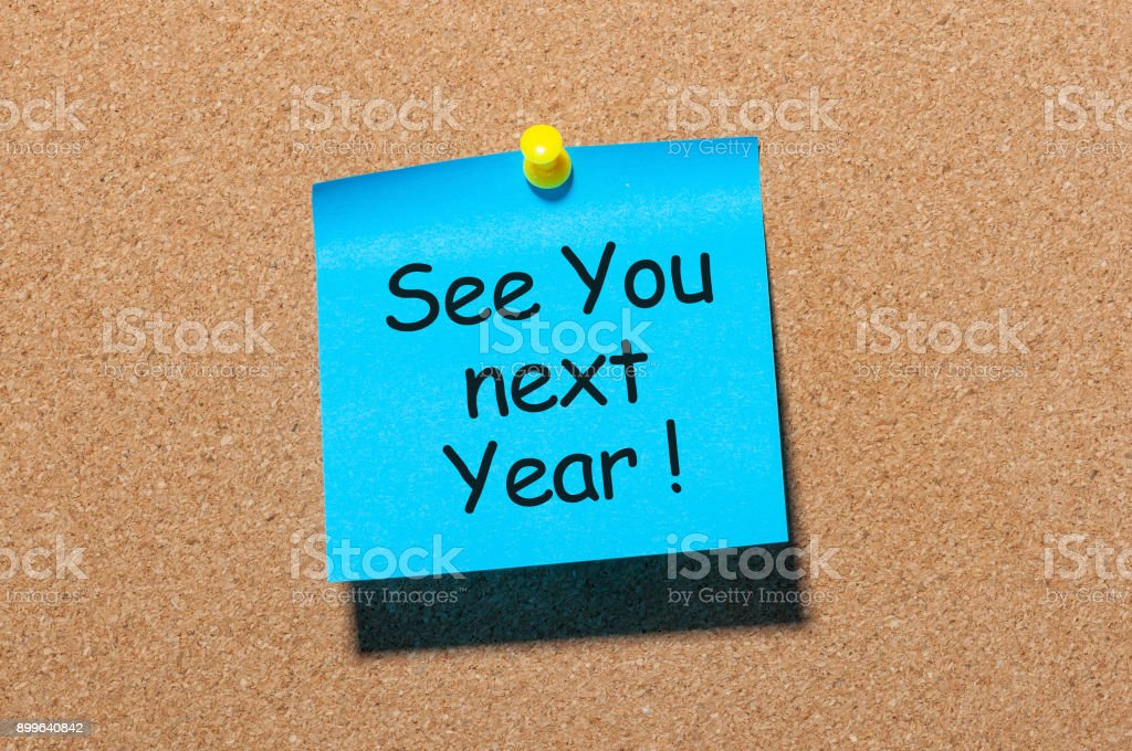 phrase See you next year pinned at cork board stock photo