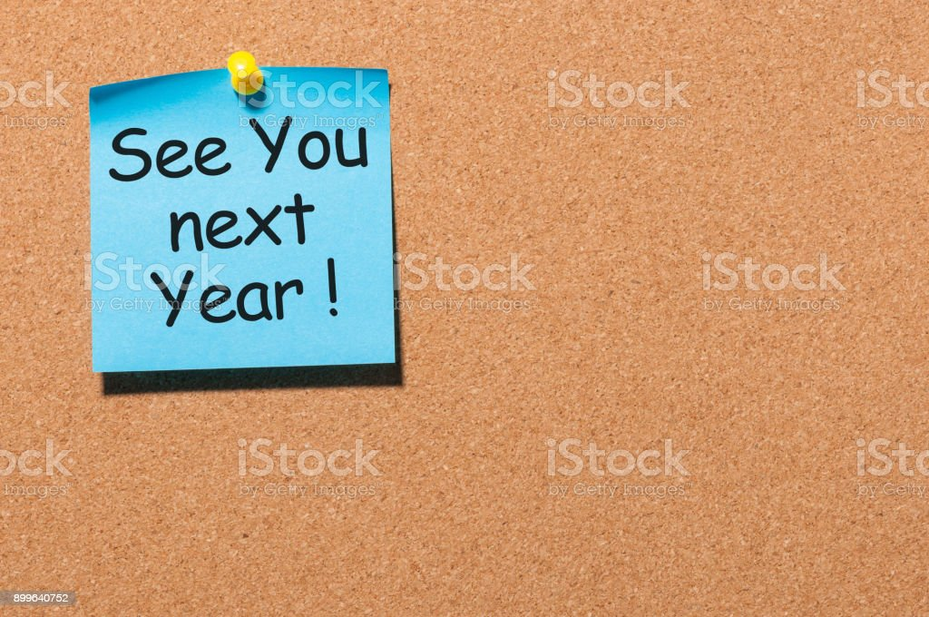 phrase See you next year pinned at cork board with empty space for text, template stock photo