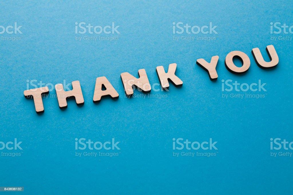 Phrase Thank You on blue background stock photo