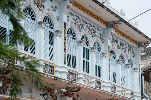 istock Phuket old town : Sino-Portuguese Architecture buildings. This architectural style is European mixed with Chinese modern, Thailand. Ancient window. 1082245852
