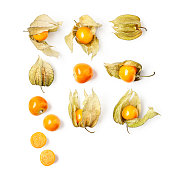 Physalis fruit collection and creative pattern isolated on white background. Healthy eating and dieting food concept. Cape gooseberry composition and design elements. Top view, flat lay