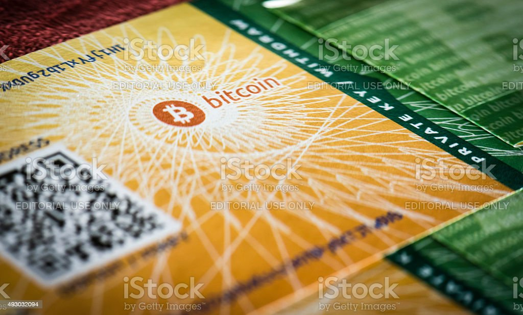 Physical Bitcoin paper wallet document Zurich, Switzerland - September 11, 2015: Close-up of a physical Bitcoin paper wallet. The Bitcoin paper wallet is a printed certificate containing data to generate  redeemable Bitcoin keys for single use. It allows to store bitcoins offline as a physical document and is commonly used for gifts and as part of physical Bitcoin coins/note. 2015 Stock Photo