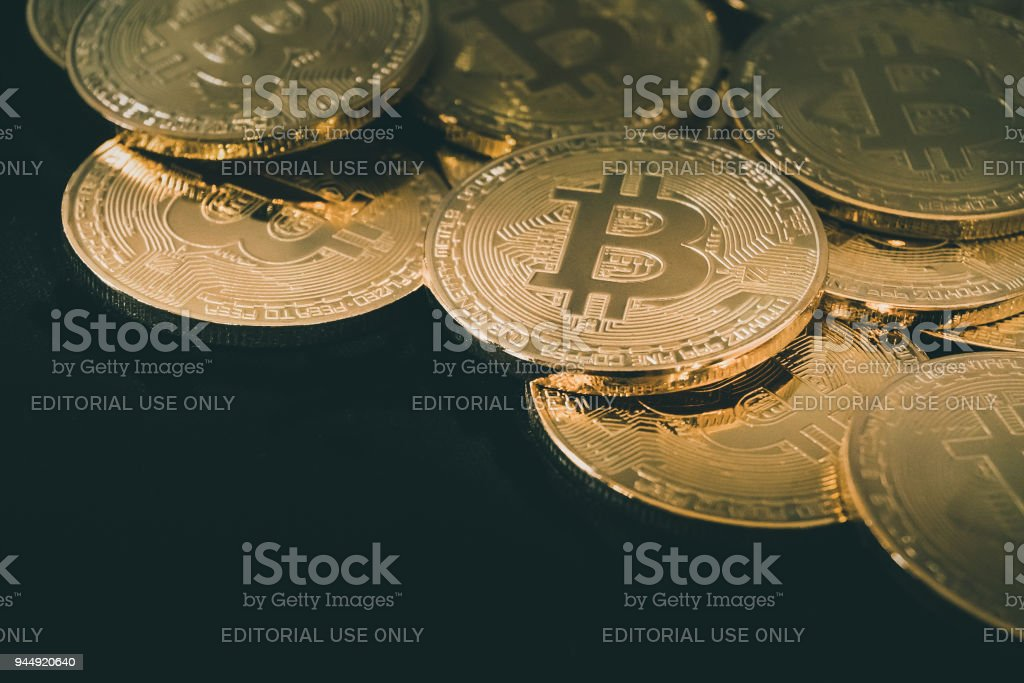 Physical Bitcoin pile background , Bitcoin mining stock photo