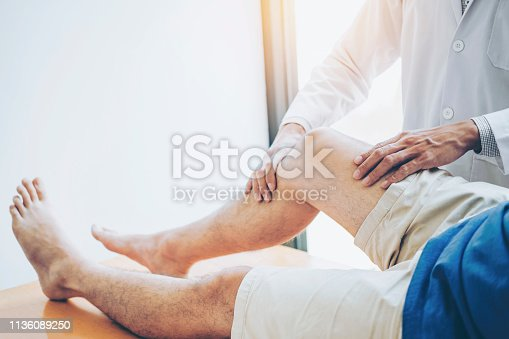 istock Physical Doctor consulting with patient Knee problems Physical therapy concept 1136089250
