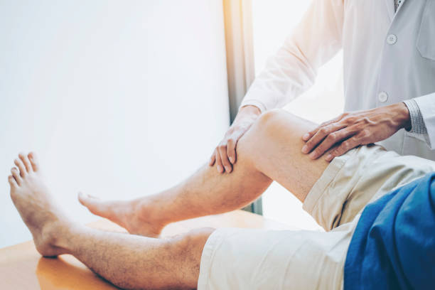 Physical doctor consulting with patient knee problems physical picture id1136089250?b=1&k=6&m=1136089250&s=612x612&w=0&h=3cxgbwcovlm5kqlnj6ptaed sdinfbma mjkz2frbga=