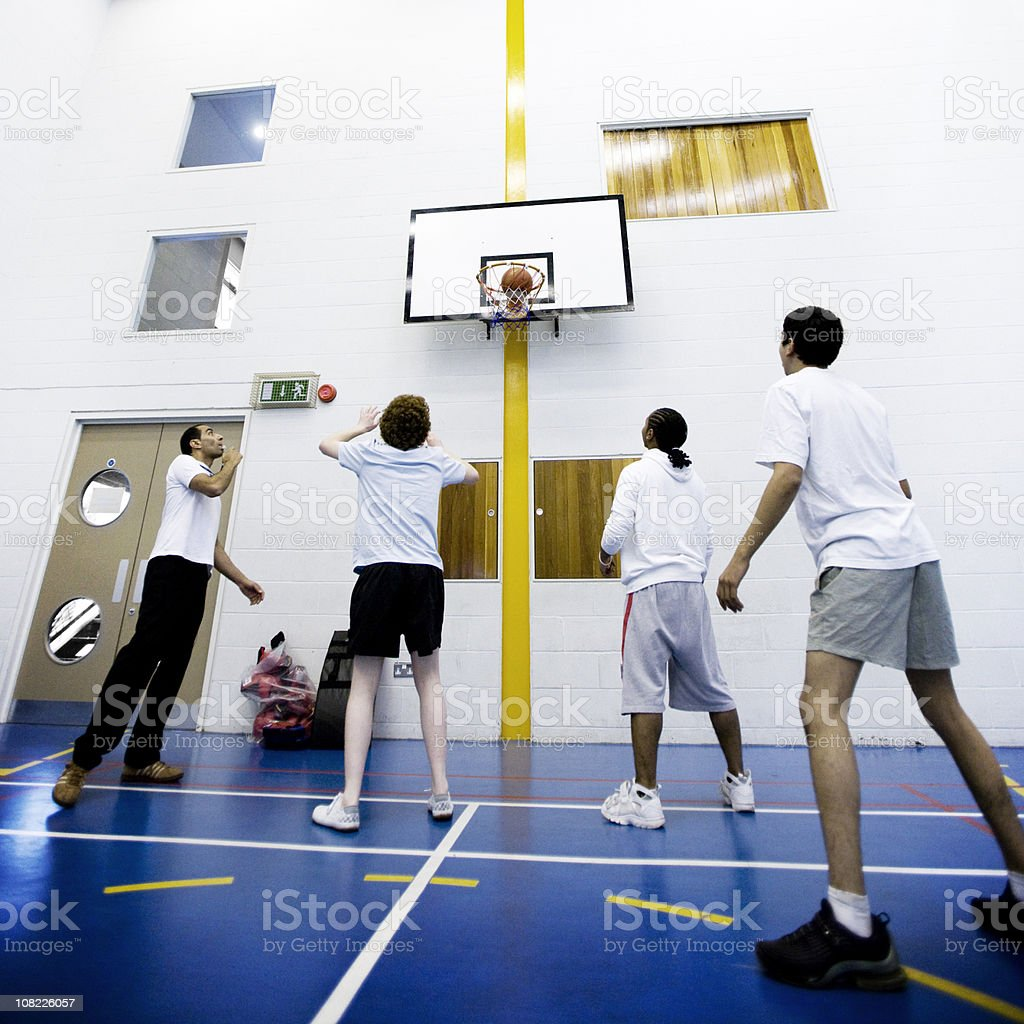 physical education: basketball lessons stock photo