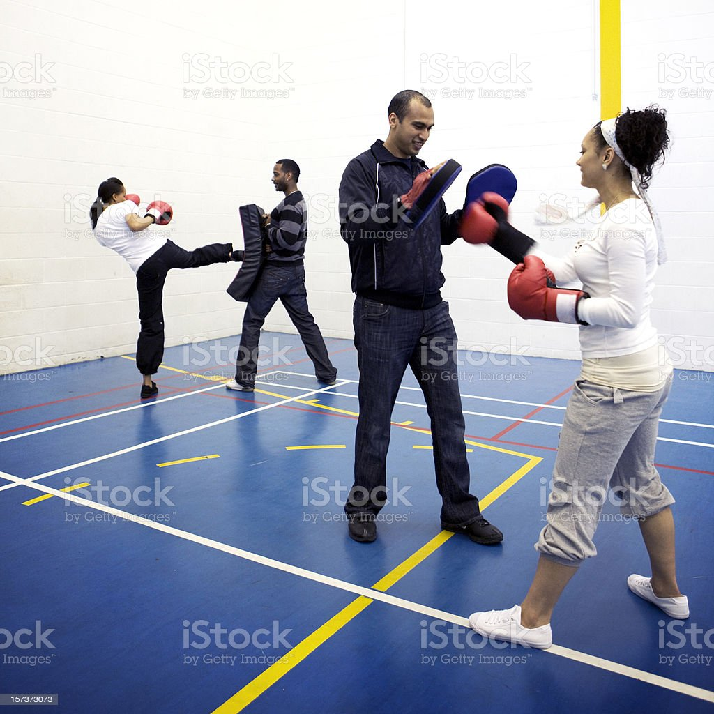 physical education: boxing training lesson with trainers working their athletes stock photo