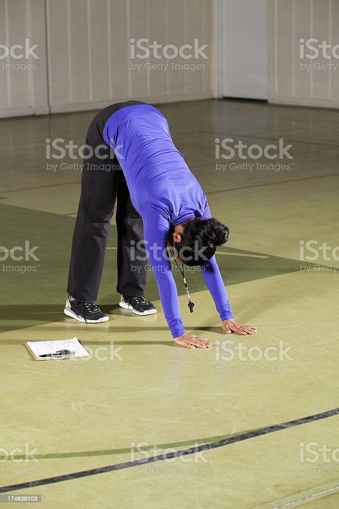 Physical education teacher stretching royalty-free stock photo
