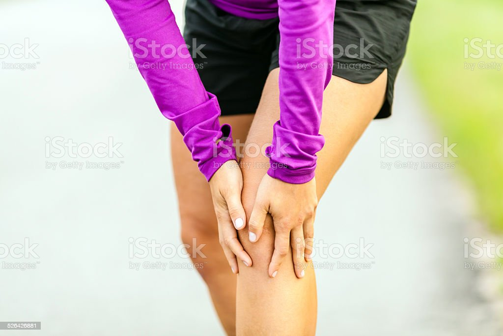 Physical injury, running knee pain stock photo