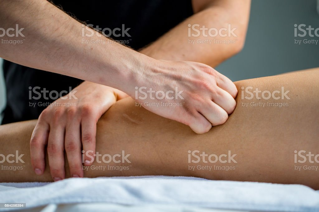 Physical Therapist Checking Woman's Leg stock photo