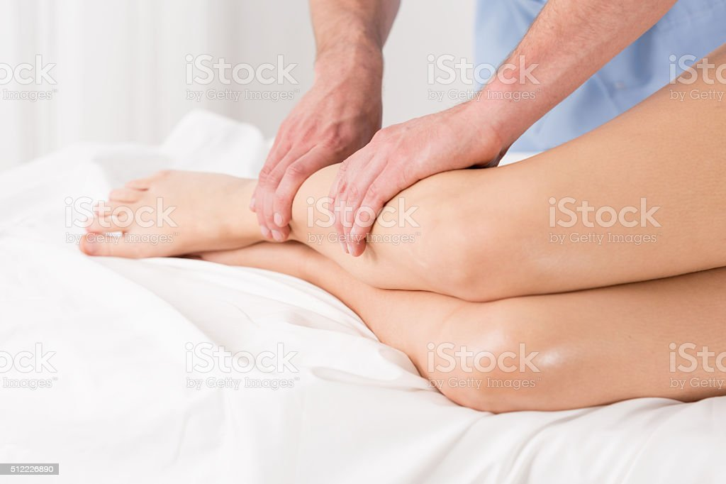 Physical therapist doing lymphatic drainage stock photo