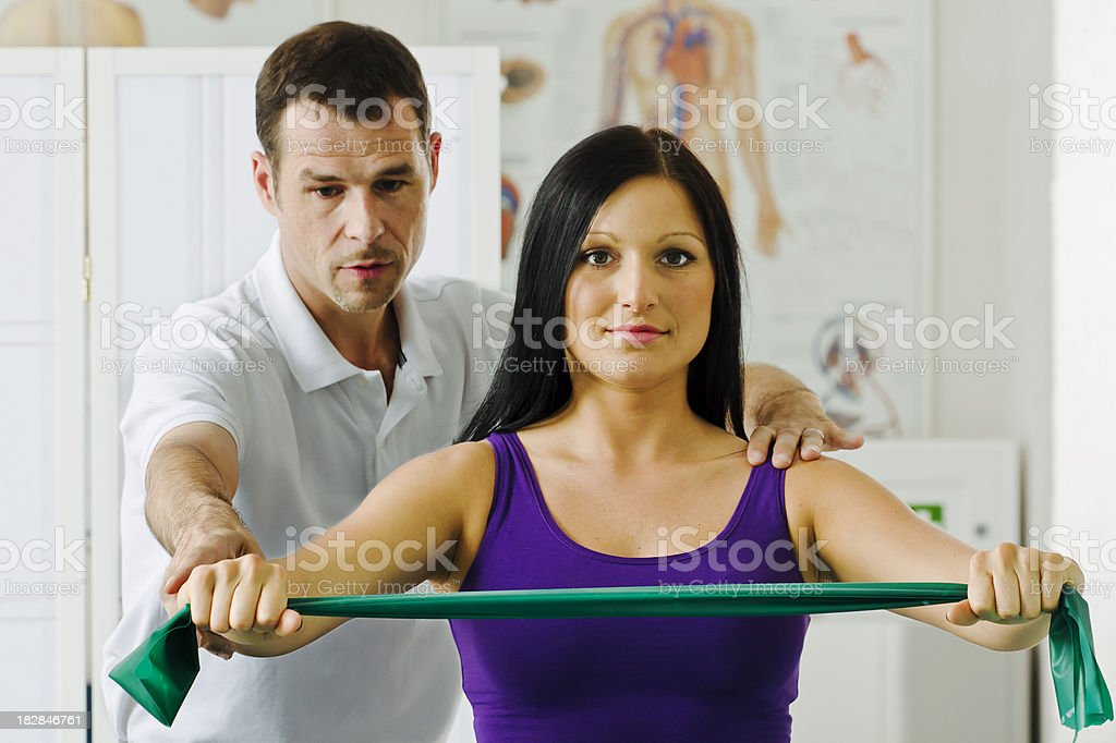 Physical Therapist Helping a Patient stock photo