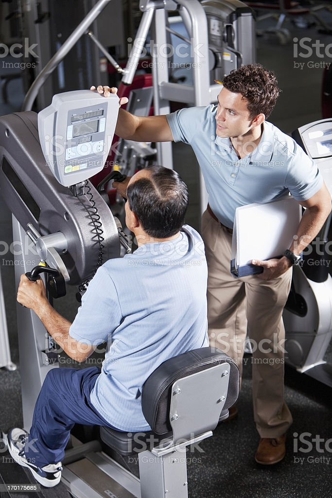 Physical therapist helping Hispanic patient royalty-free stock photo