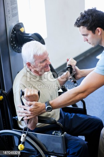 istock Physical therapist helping patient 187045329