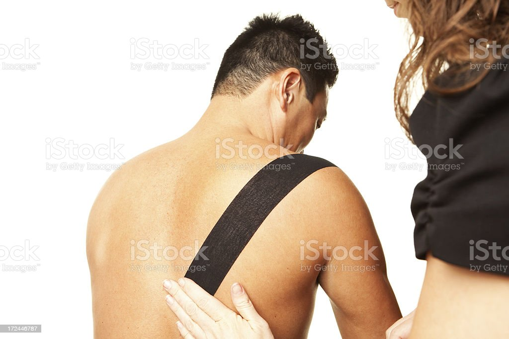 Physical Therapist Taping Man's Shoulder stock photo