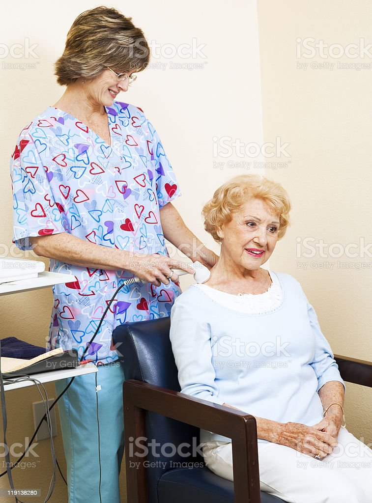Physical Therapist Using Ultrasound royalty-free stock photo