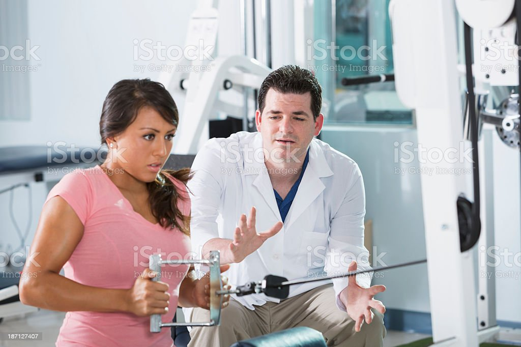 Physical therapist with patient stock photo