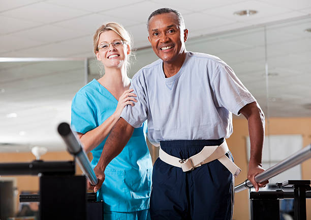 Physical therapist working with a patient stock photo