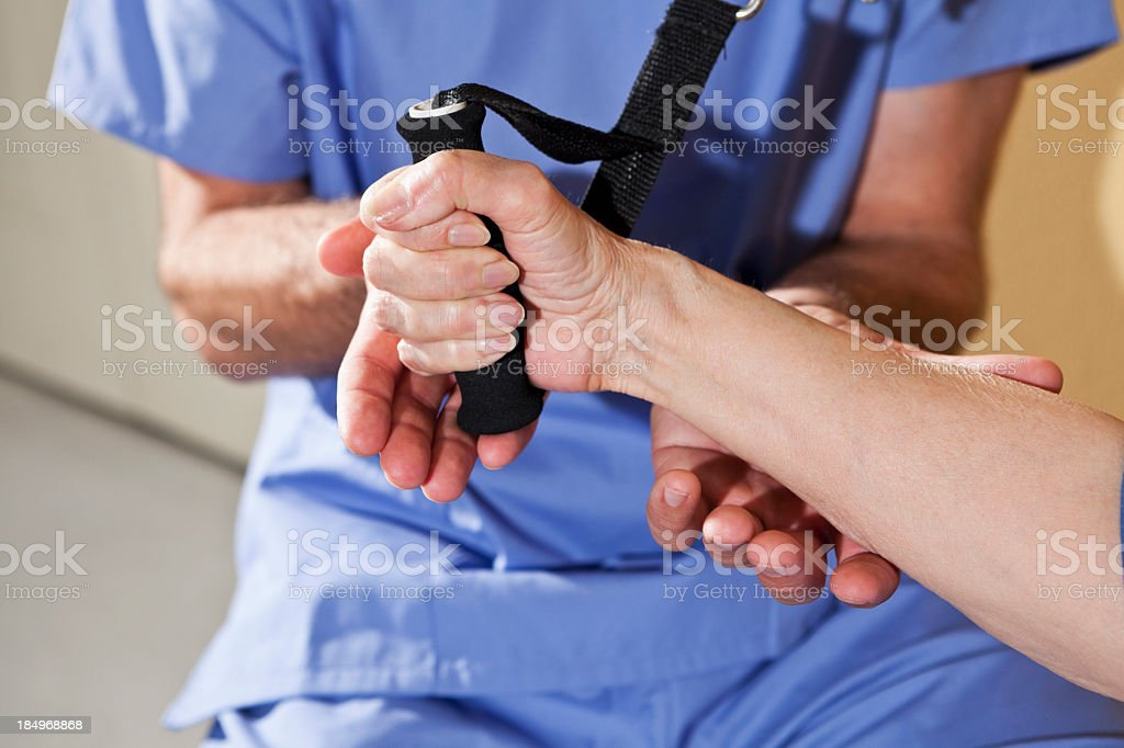 Physical therapist working with patient on upper extremity exerc royalty-free stock photo