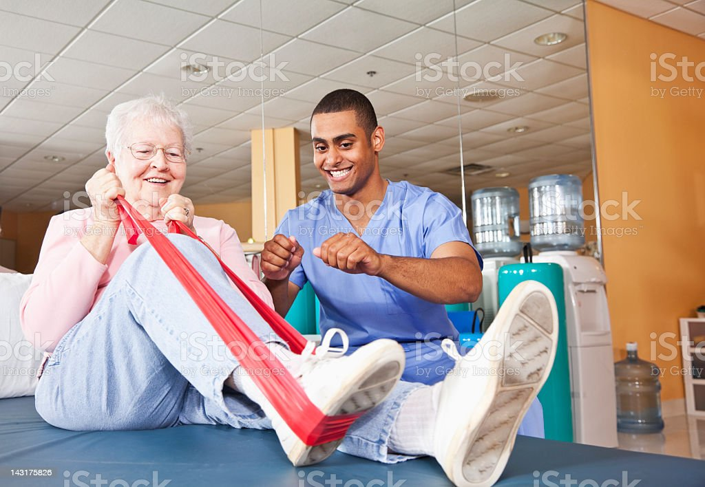 Physical therapist working with patient royalty-free stock photo