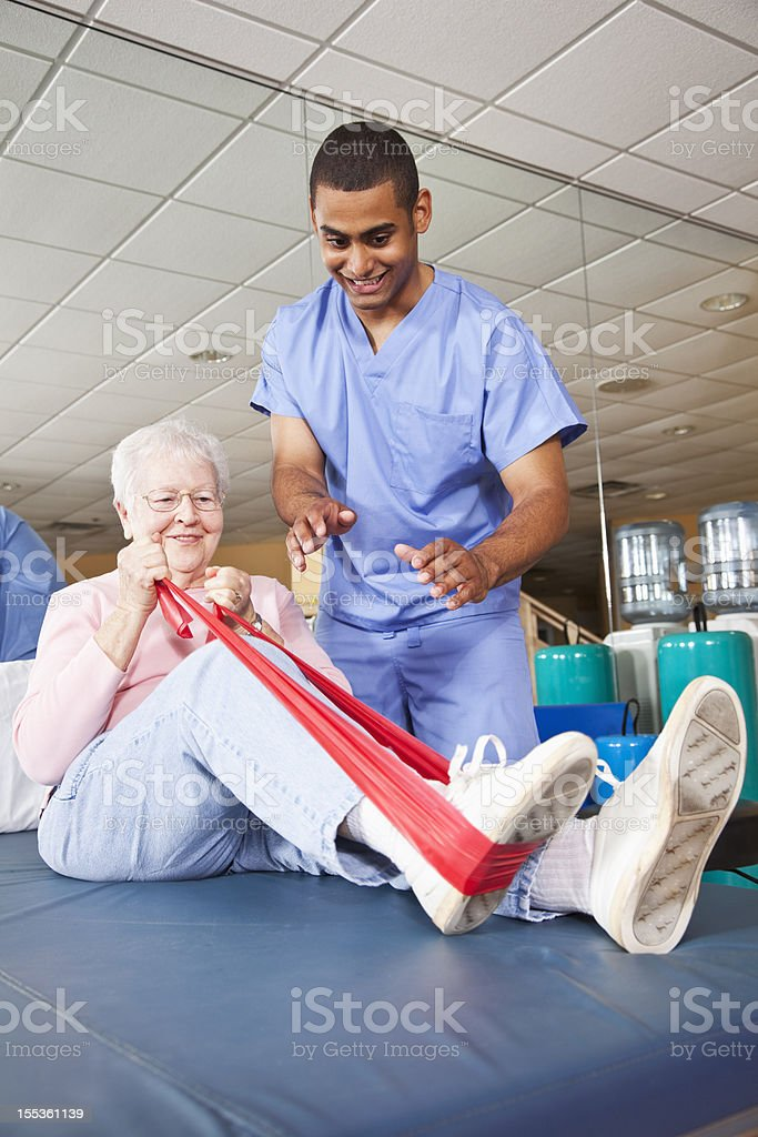 Physical Therapist Working With Patient Stock Photo ...