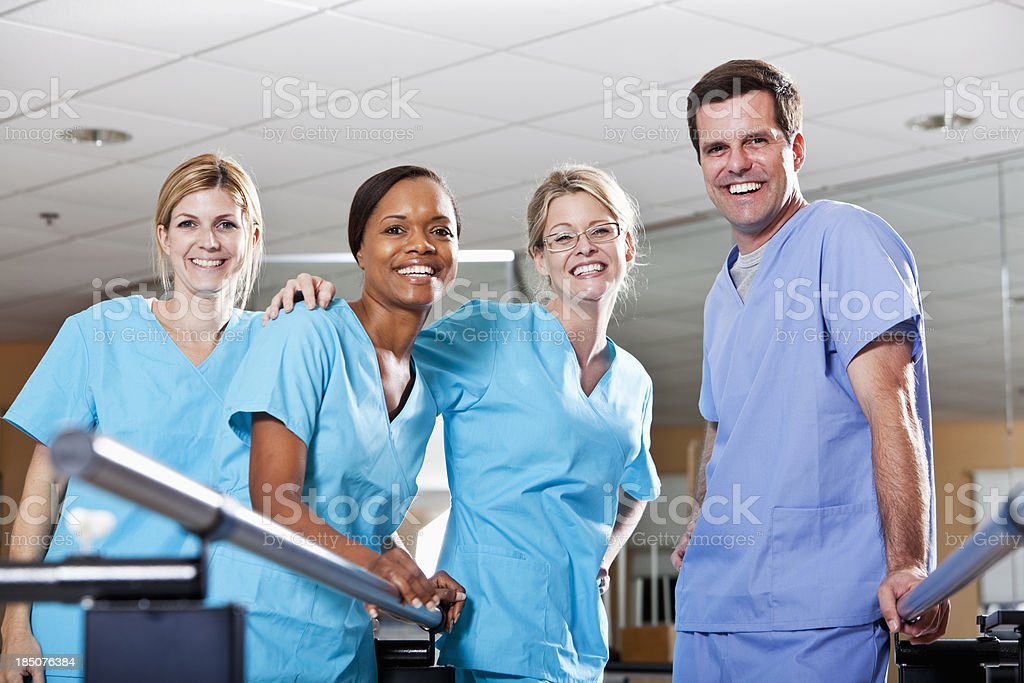 Physical therapists in rehabilitation room stock photo