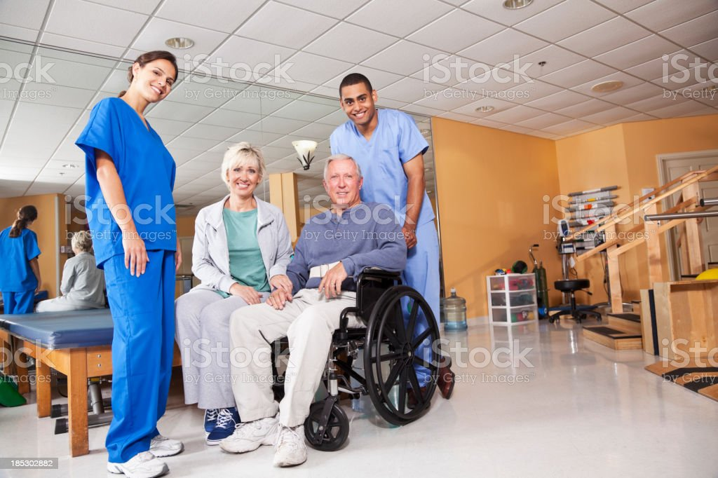 Physical therapists with patient and spouse royalty-free stock photo