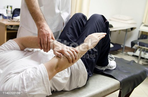 609830806 istock photo Physical therapy exercise for arm pain at the clinic. 1140203159