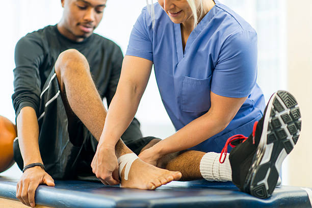 physical therapy - sports medicine stock photos and pictures