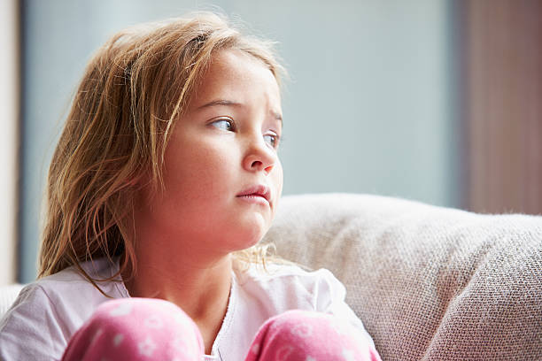 Physically Abused Child At Home Sitting On Sofa Physically Abused Child At Home Sitting On Sofa 8 9 years stock pictures, royalty-free photos & images
