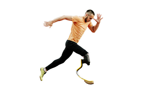 physically disabled athlete running stock photo