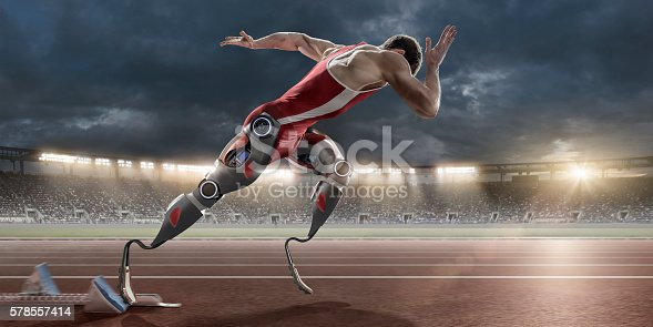 istock Physically Disabled Athlete Sprinting From Blocks With Artificial Robotic Legs 578557414