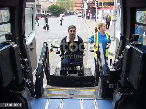 Dublin, Ireland - May 17, 2008: Wheelchair lift for a bus in Dublin, Ireland. The vehicle is equipped with a special wheelchair lift on the backside of the bus. This is important equipment for many bus operators and helps a lot of people with physical disabilities.