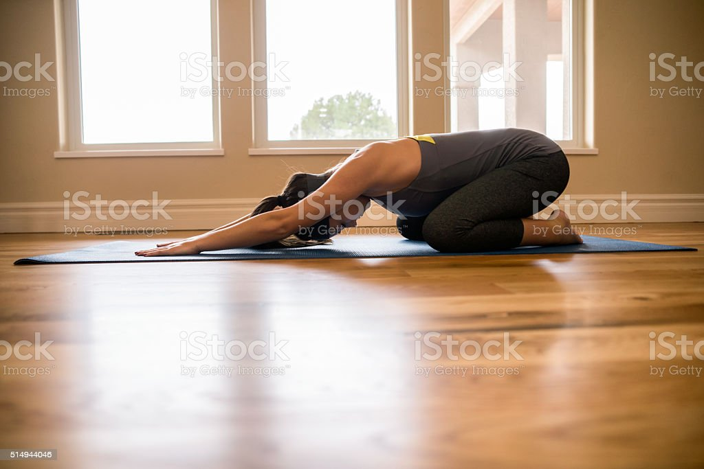 Physically Fit Young Woman Practicing Yoga Childs Pose Living Ro stock photo