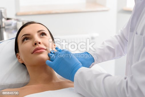 istock Physician administering liquid in skin of outgoing girl 685845700