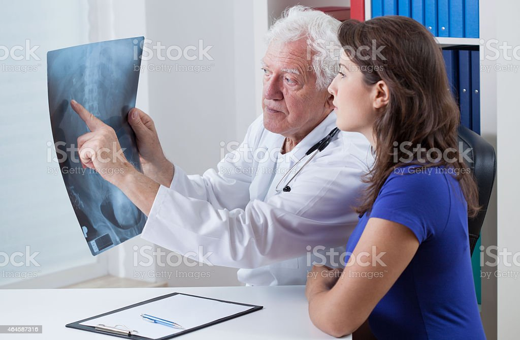 Physician showing rtg to his patient stock photo