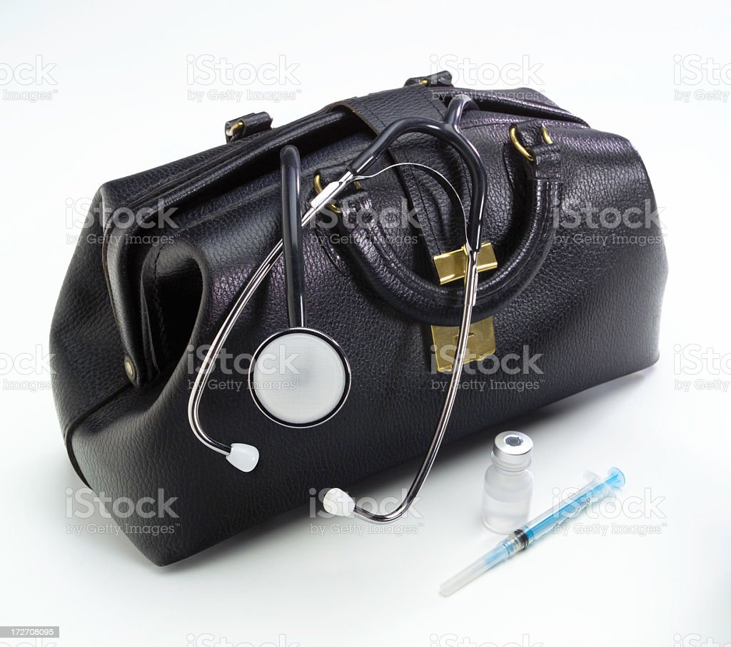 Physician's leather black bag with stethoscope & syringe royalty-free stock photo
