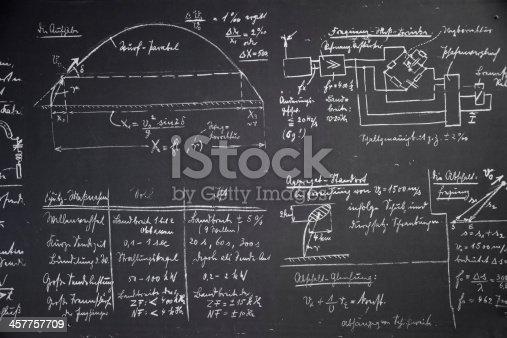 istock Physics equations written in white chalk on blackboard 457757709