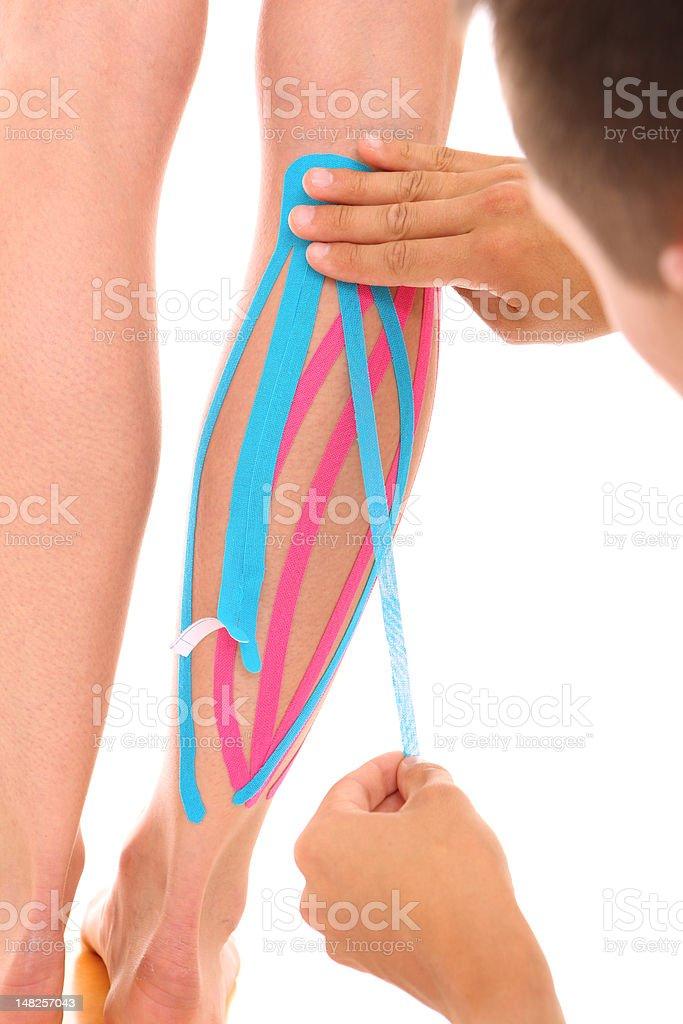 Physio tape treatment royalty-free stock photo