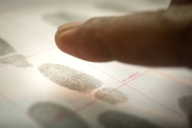 physiological biometrics concept for criminal record by fingerprint in cinematic tone - record stock pictures, royalty-free photos & images