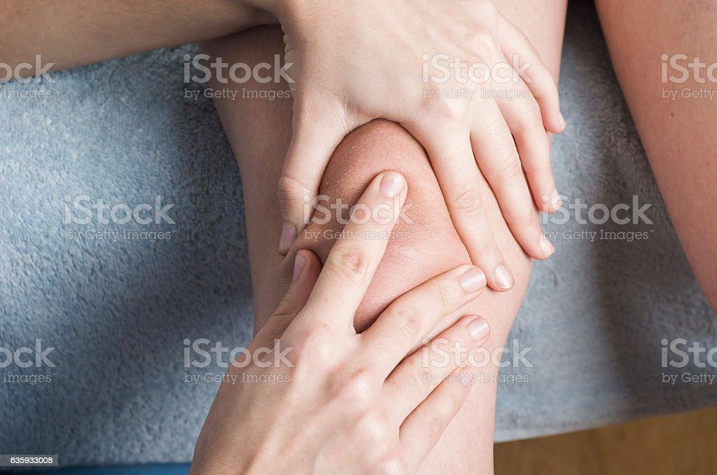 Physiotherapist, chiropractor doing a patellar mobilization, Kne stock photo
